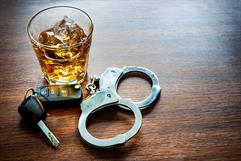 Alcohol, car keys and handcuffs - Felony DWI Defense